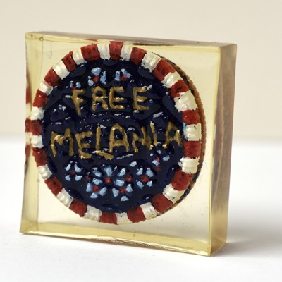 ''Protest Biscuit - Free Melania'' biscuit in resin by Sian Pattenden