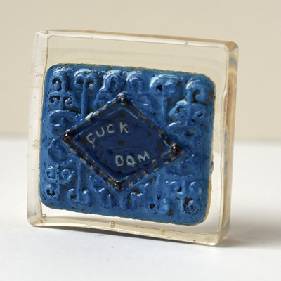 ''Protest Biscuit - Fuck Dom'' biscuit in resin by Sian Pattenden
