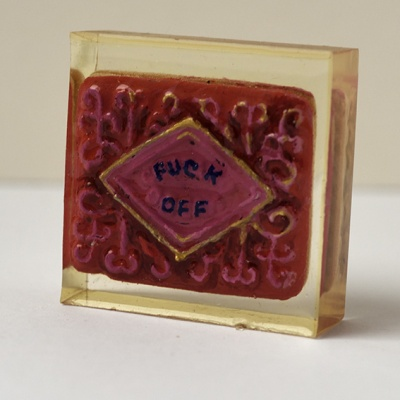 ''Protest Biscuit - Fuck Off'' biscuit in resin by Sian Pattenden