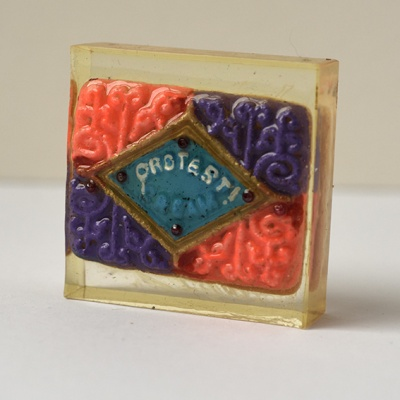 ''Protest Biscuit 2'' handpainted biscuit in resin by Sian Pattenden