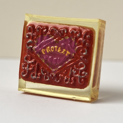 ''Protest Biscuit 3'' handpainted biscuit in resin by Sian Pattenden
